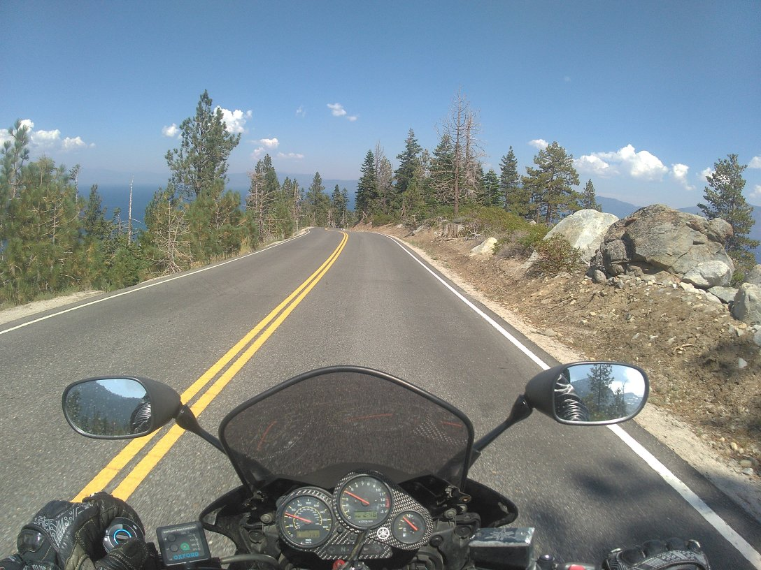 #2h1hz onboard a motorcycle riding on a mountain asphalt road