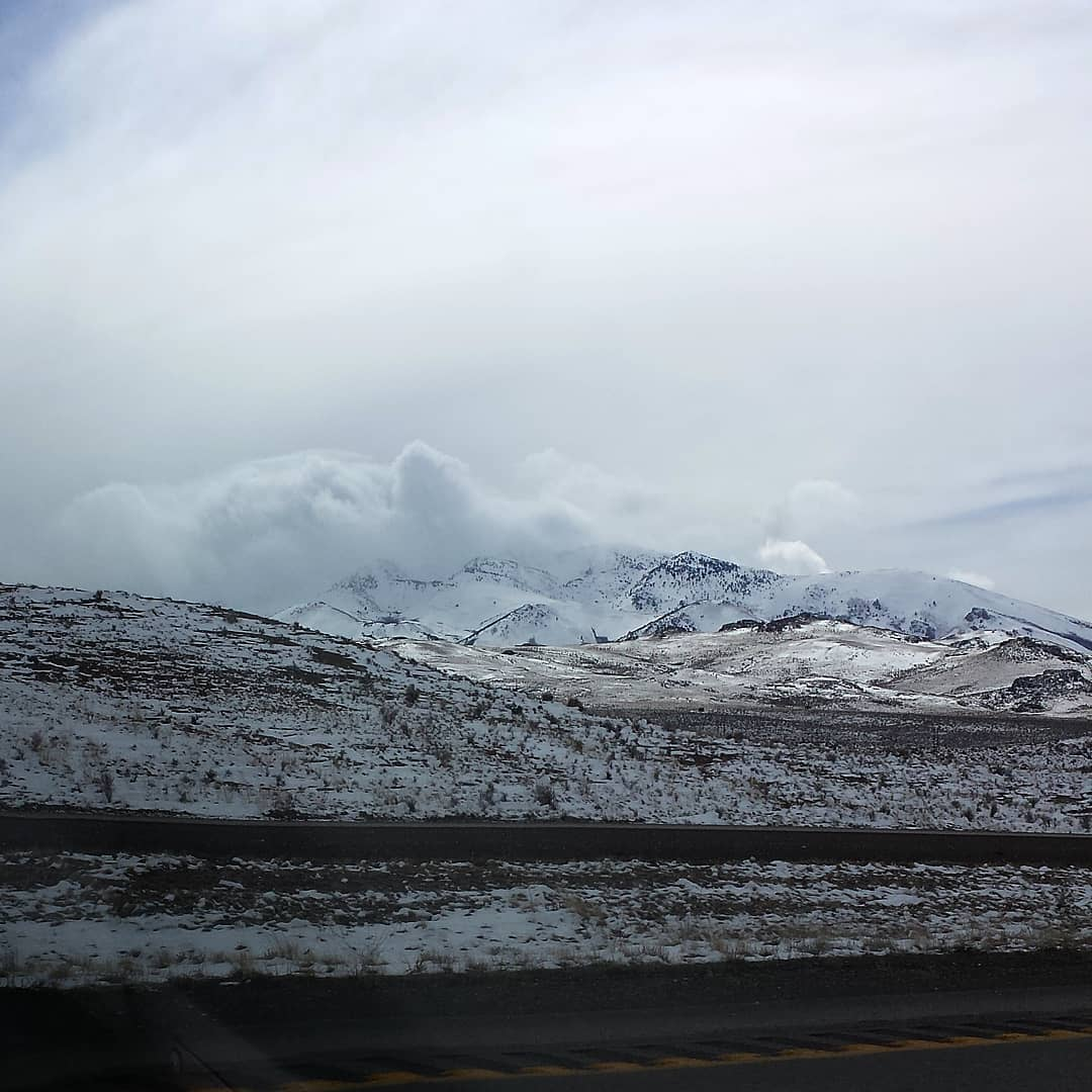 clouds and snowy mountains
