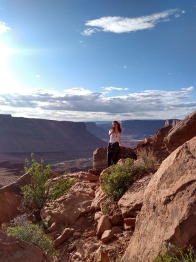 woman on mountainside with panorama landscape