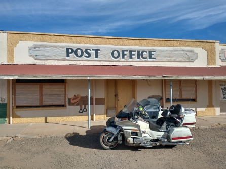 motorcycle sidecar in front of post office in texas, van horn